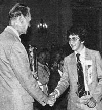 <p><strong>Mr. Charlton</strong> congratulating <strong>Colin Caldwell</strong> (1976).</p>