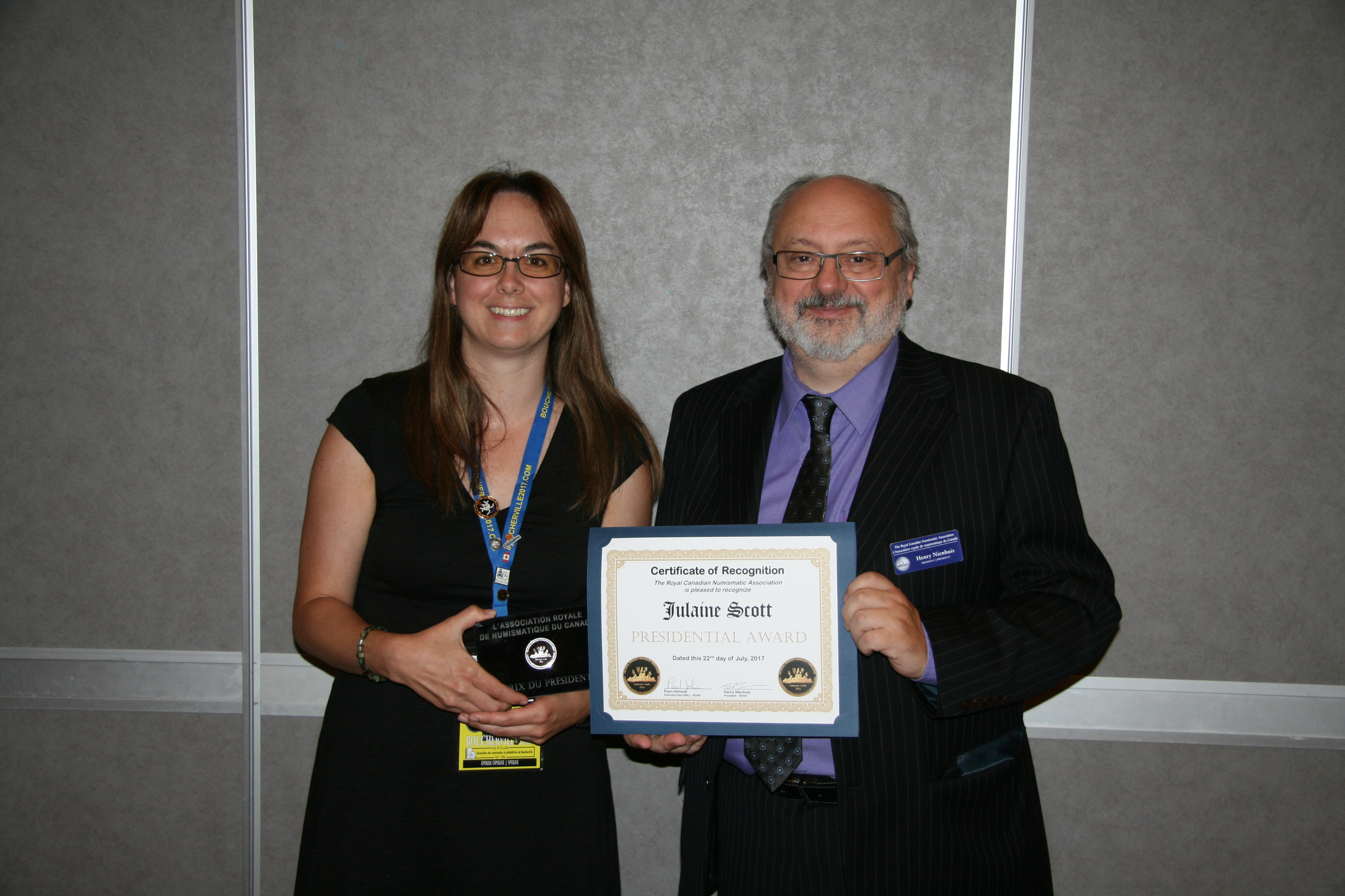<p><strong>Julaine Scott</strong> (left) receiving Presidential Award from <strong>Henry Nienhuis</strong> (right).</p>