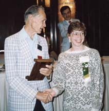 <p><strong>Mr. Charlton</strong> congratualting <strong>Kimberly Blaylock</strong> (1990)</p>