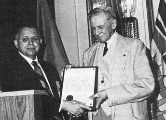 <p><strong>John Jay Pittman</strong> presenting the J. Douglas Ferguson Award to <strong>Guy Potte</strong>r at the 1971 C.N.A. Convention<br />(left to right)</p>